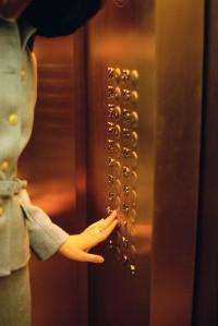 Businesswoman Pushing Elevator Button